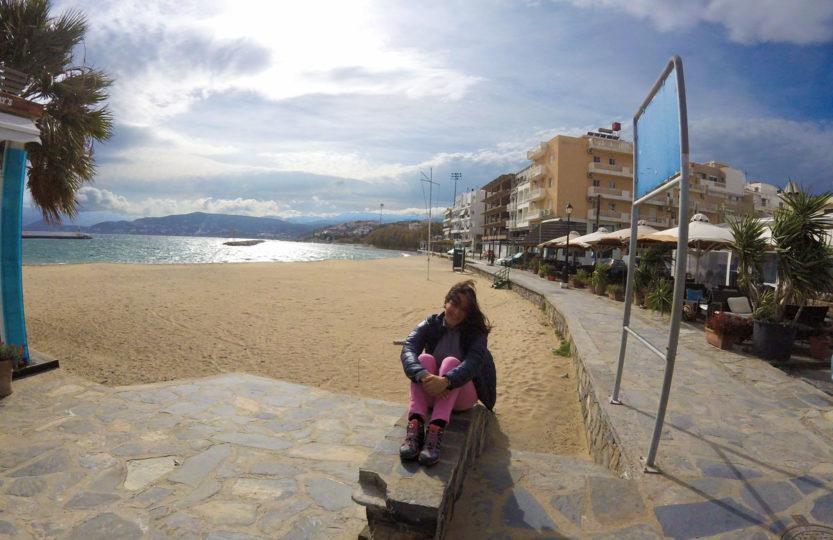 Cycling travel, Yasmina at the beach of Agios Nikolaos in Crete.
