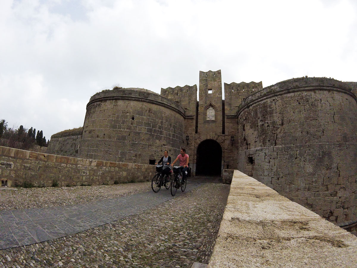 Cycling, cycling in the old fortified town of Rhodes, Greece. Cycling travel, cycling in Rhodes Old Town, Greece.