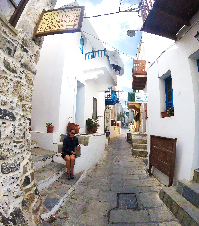 Bike trip, Yasmina in the village of Mandraki, March 2018, Island of Nisyros, Dodecanese, Greece. Cycling trip, Yasmina at Mandraki Village, March 2018 in Nisyros Island, Dodecanese, Greece.