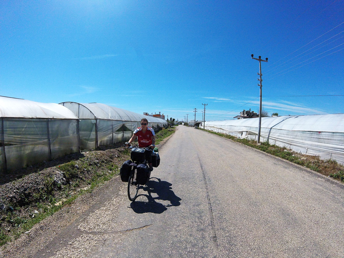 Turkey cycling in the middle of the tomato greenhouses in Mavikent. Cycling Turkish in the middle of tomatoes green houses in Mavikent.
