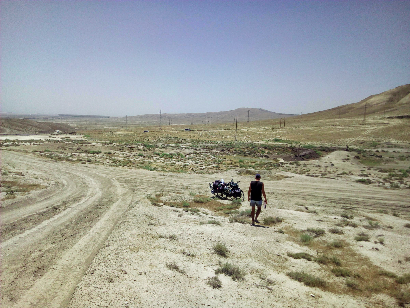 Cycling, Azerbaijan Cycling, crossing the Caucasus region by bike, road near the Gobustan mud volcano. Cycling travel, biketouring, cycling Caucasus, cycling Azerbaijan, road near Gobustan Mud Volcano.