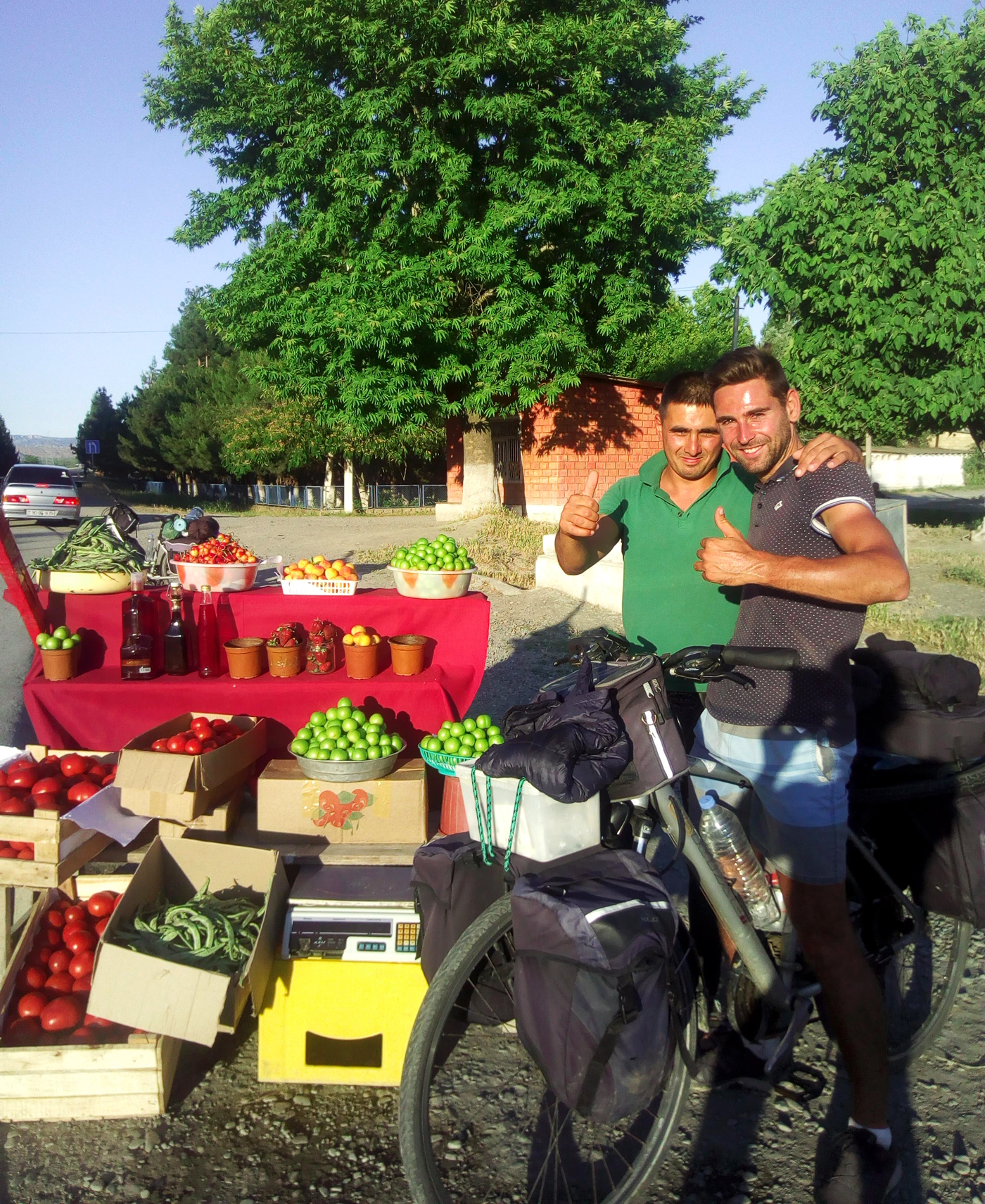 Cycling, Azerbaijan Cycling, crossing the Caucasus region by bicycle, fruit and vegetable merchant on the roadside. Cycling travel, biketouring, cycling Caucasus, fruits and vegetables seller on the side of the road.