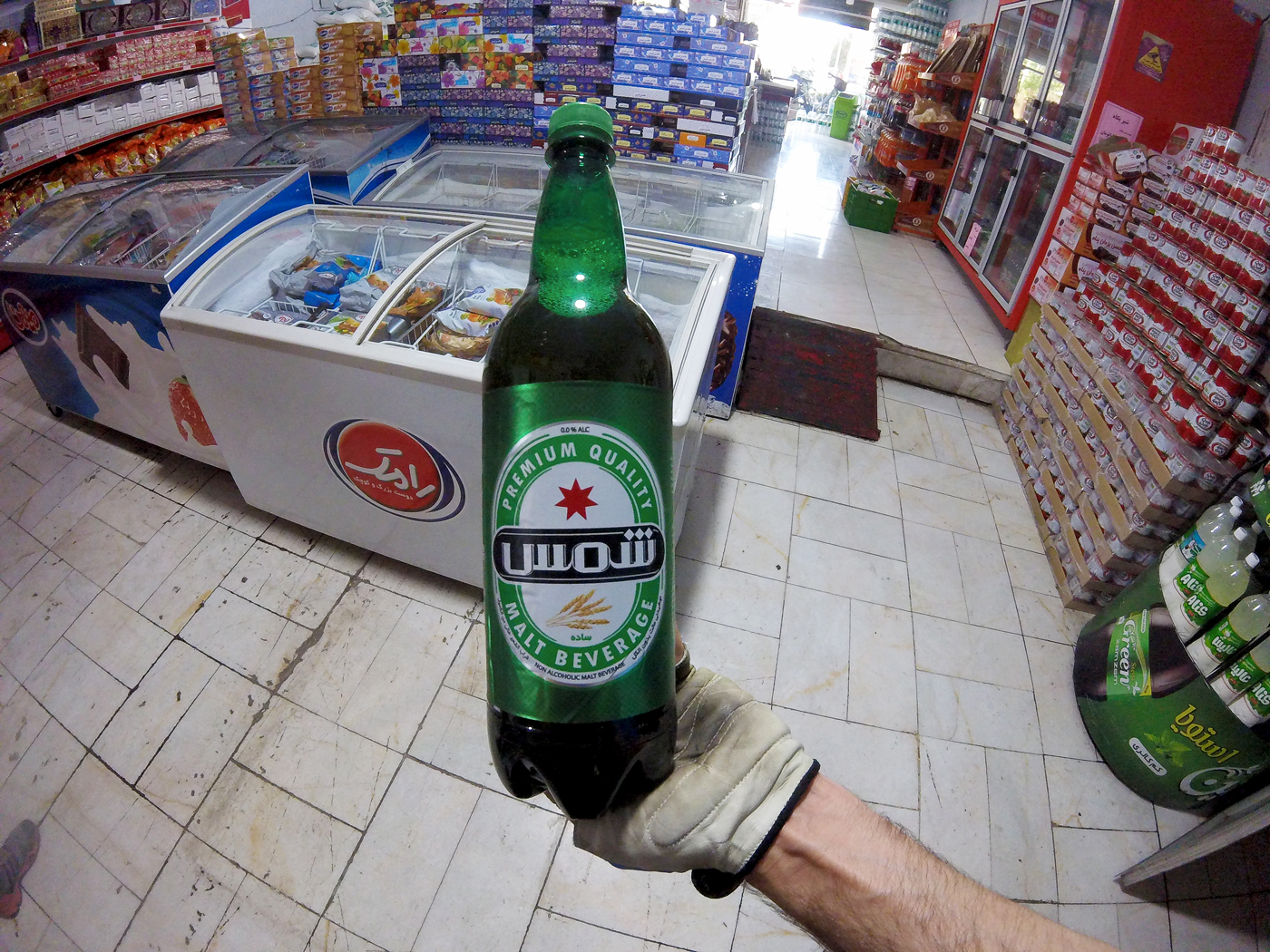 Bike trip, cross Iran by bike, malt drink, local beer without alcohol. Cycling travel, biketouring, cycling Iran, malt beverage.