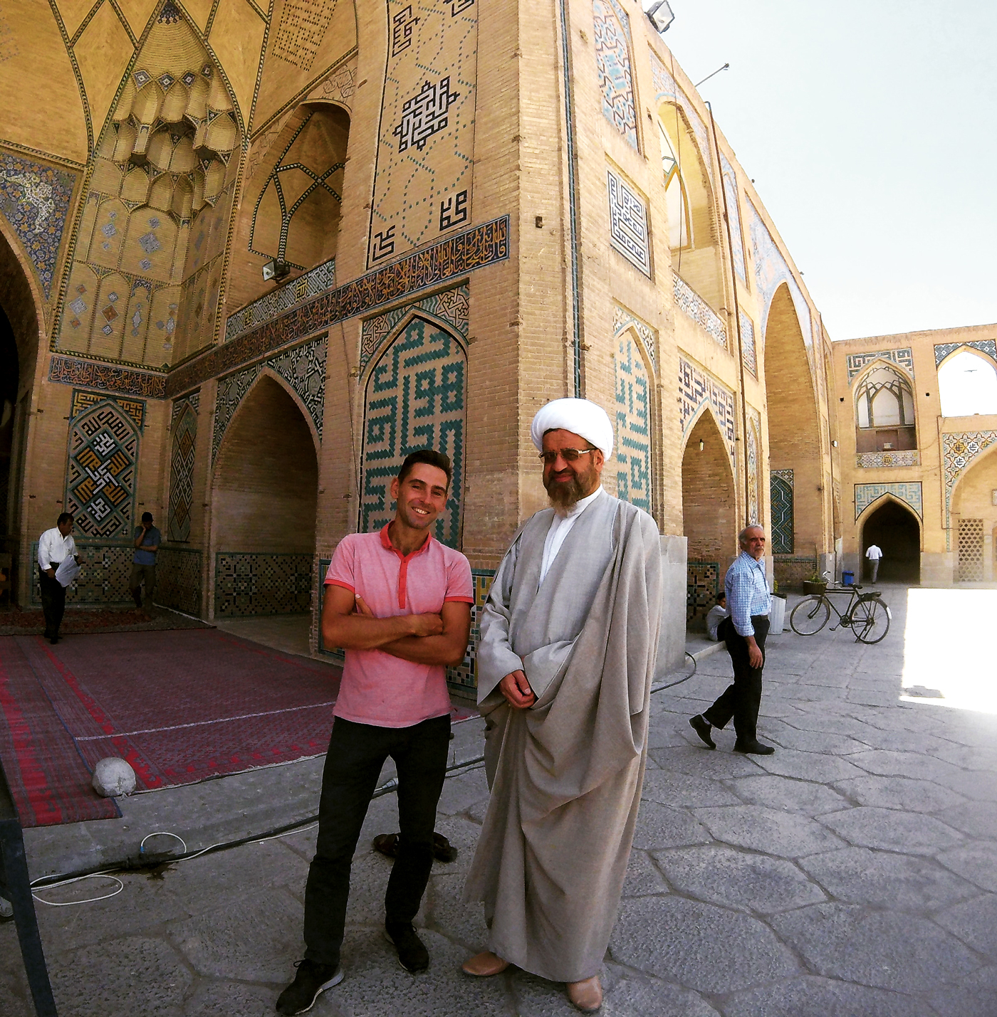 Cycling, crossing Iran by bicycle, with Mullah Haj Agha (religious leader in Shia Islam) from the Hakim Mosque in Isfahan. Cycling travel, biketouring, cycling Iran, with the mullah (religious leader in Shiite Islam) of Hakim Mosque in Isfahan.