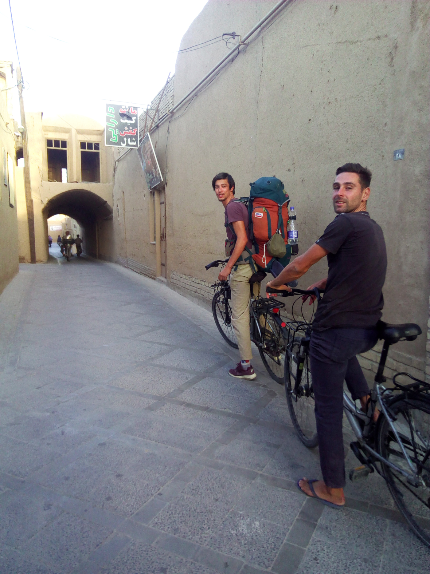 Bike trip, cross Iran Cycling, Arthur and Vincent biking in the streets of Yazd. Cycling travel, biketouring, cycling Iran, Arthur and Vincent cycling through the streets of Yazd.